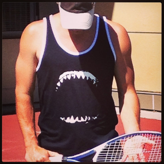 Sports jersey style tank top with great white shark jaws on the front and jersey number and the word